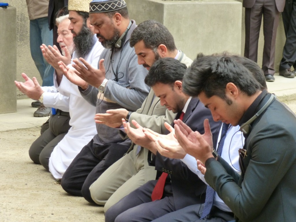 """The Muslim delegation in prayer at the infamous """"Wall of Death"""" at Auschwitz where prisoners were routinely shot to increase fear in others. (photo: Susan Barnett)"""