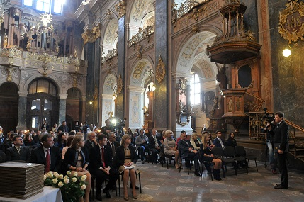 """Finalists of the """"Face of the City"""" award, members of the Lviv City Council and of the Chamber of Commerce  and clergy sit in the 17th century Church of Saint Peter and Paul,  waiting for the announcement of the winners by Volodymyr Korud, Head of the City Councils Department of International Relations."""