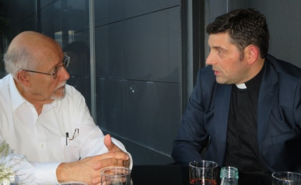Rabbi Bemporad (L) discusses minority religions in Kosovo with Fr. Kastriot Idrizi during a recent visit.