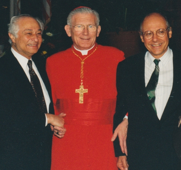 At his elevation to Cardinal in Rome in 1994, Cardinal William Henry Keeler (center) locks arms with Rabbi Jack Bemporad, CIU Director (right).  Joseph Ehrenkranz, co-founder of the Center for Christian-Jewish Understanding at Sacred Heart University in CT (left).